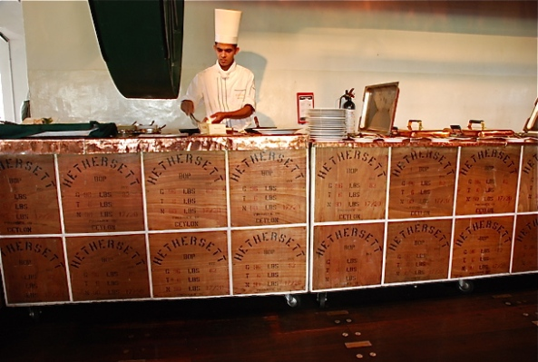 The wooden tea cartons hold the buffet area
