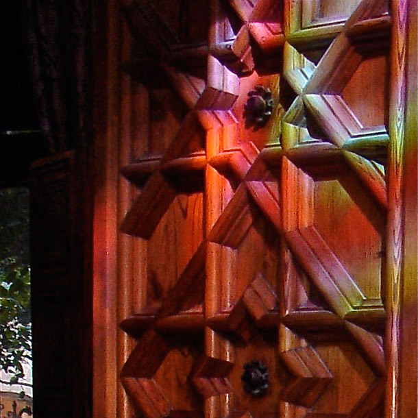 Reflection of stained glass on a wooden door