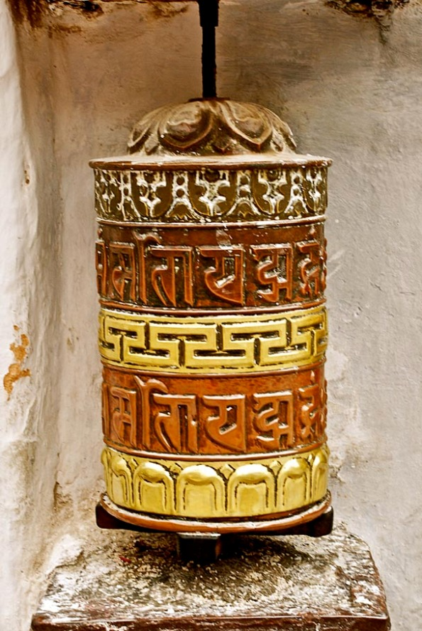The Buddhist Chant - 'Om Mani Padme Hum' inscribed on a prayer wheel