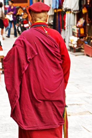 A Lama walks past. Lama is a title for a Tibetan teacher of the Dharma