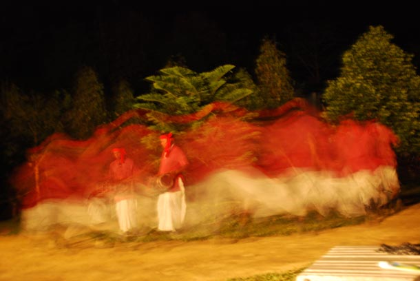 Thiru dancers, blurred by their motion