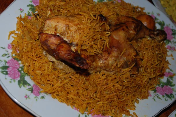 Machboos Dajaj/Chicken cooked with Yellow Rice