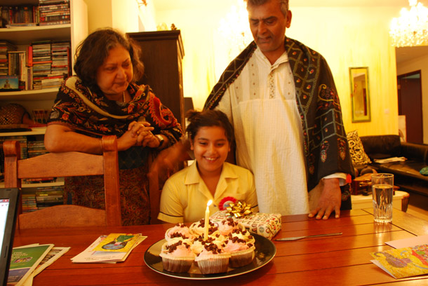 Big Z turns 8! Cutting a cake before going to school - my parents look on