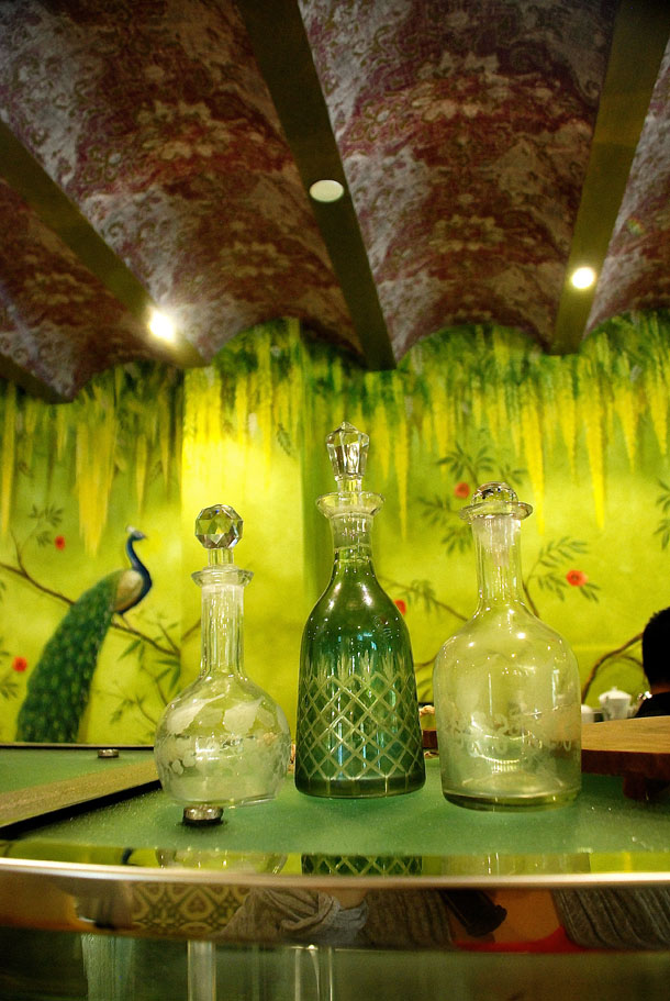 An intricately hand painted wall complimenting the hand crafted bottles