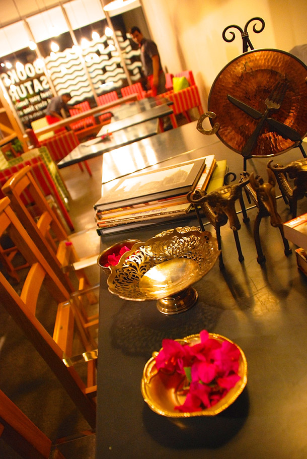 Table decoration with personal silver bowls, folk artefacts from Bengal